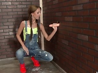 Svelte Pretty Gal With Lovely Braids Is Active With Gargling Faux Rod