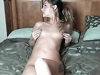 Pretty Dame With A Neck Tattoo Shows Her Trimmed Vulva