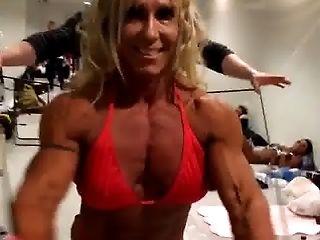 Hot Muscle Woman In Crimson Swimsuit