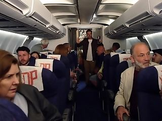 Pilot And A Duo Of Sexy Flight Attendants Fuck On The Plane